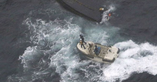 Japan sends home 3 N. Koreans rescued from capsized boat