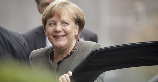 Merkel presses on with German gov't talks, length unclear