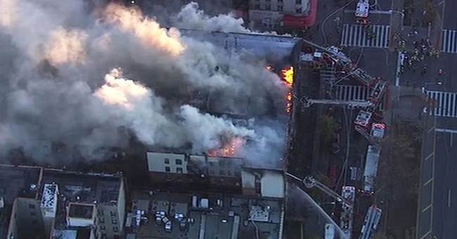 9 injured in large fire atop 6-story apartment building