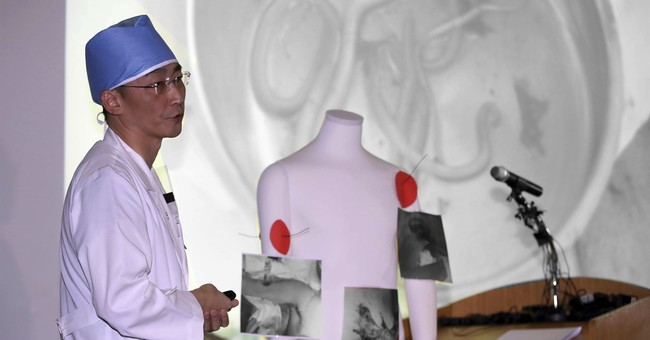 Surgeons remove worms, parasites from N. Korean soldier