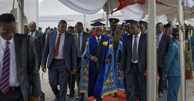 The Latest: Zimbabwe ruling party pursues urgent meeting