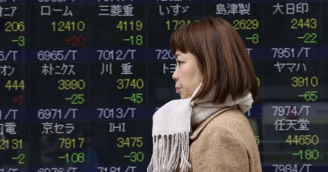 Asian shares fall in muted trading ahead of Thanksgiving