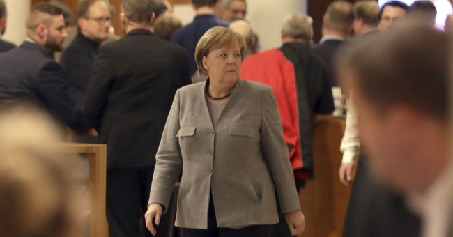 The Latest: Merkel regrets failure of talks on coalition