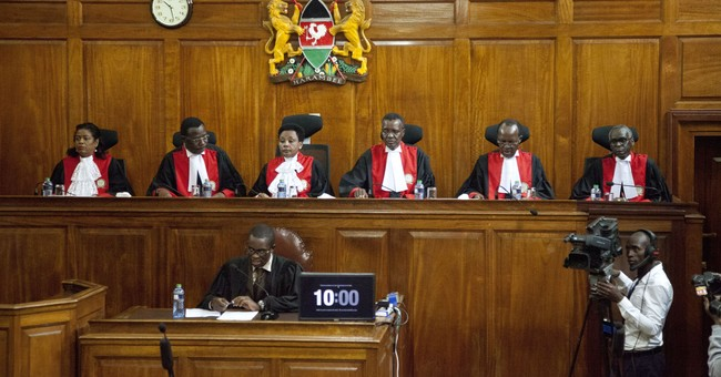 The Latest: Kenya police say 2 dead after court upholds vote