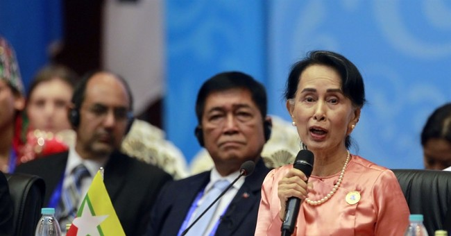 The Latest: Suu Kyi blames conflicts on illegal immigration