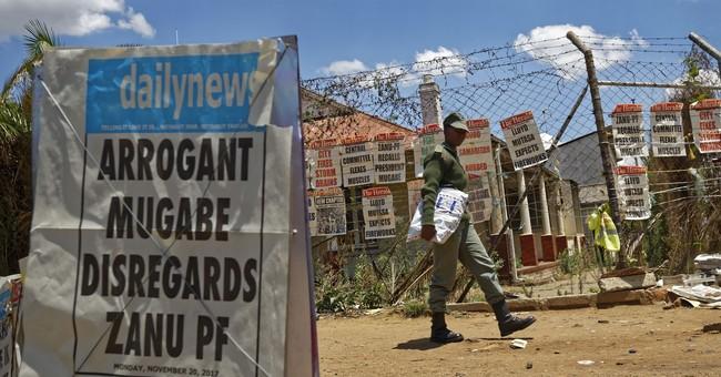 The Latest: Zimbabwe army says Mugabe working on 'solution'