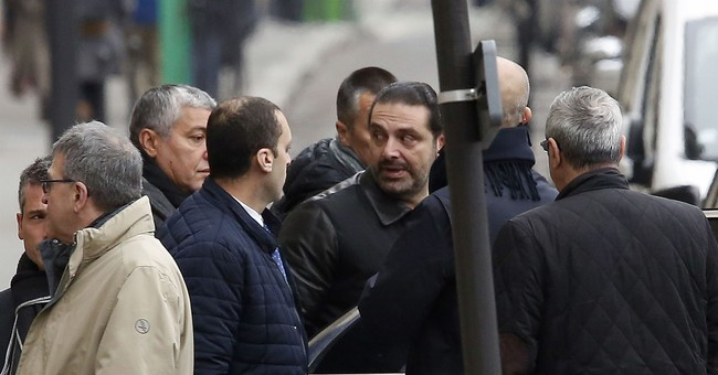 The Latest: Lebanon PM Hariri prays at father's grave