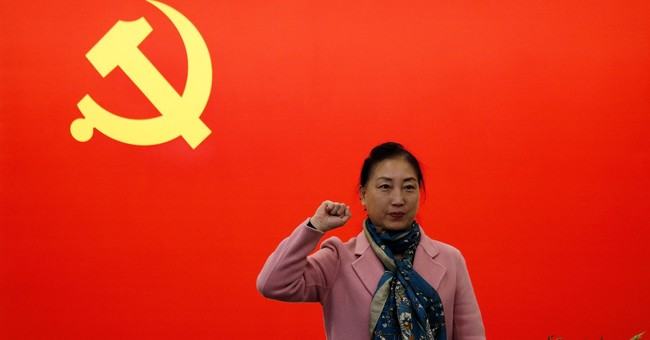 China widens personality cult around 'unrivaled helmsman' Xi