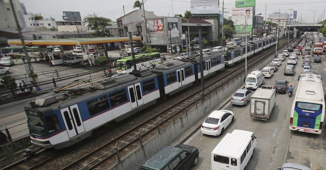 Ex-officials accused of corruption in Manila train contract