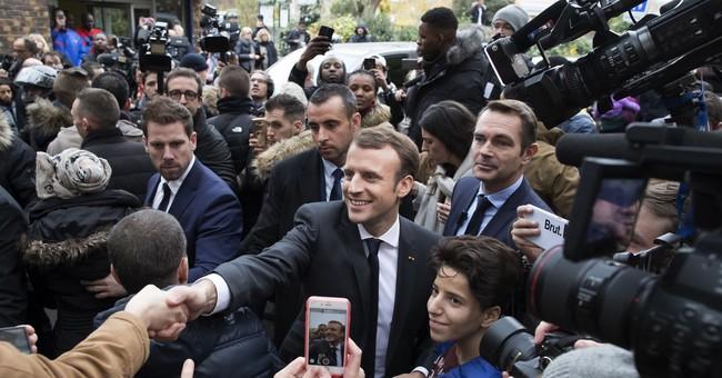 Macron takes Europe's center stage while Merkel falters