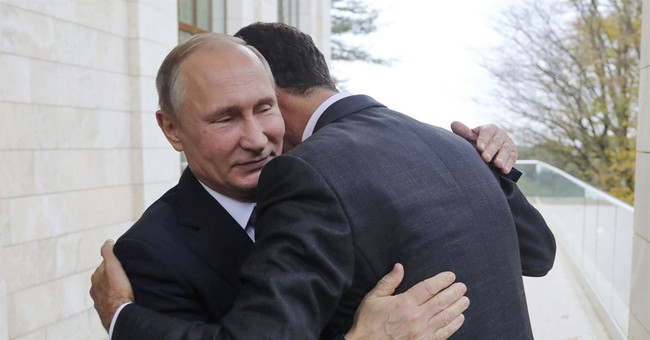 Assad-Putin embrace tells story of Russia's Syria campaign