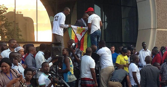 The Latest: Zimbabwe's Mnangagwa kept contact with military