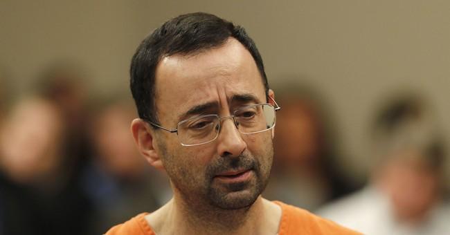 The Latest: Victims of ex-gymnastics doctor blame university