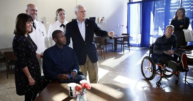 Pence visits injured service members at military hospital