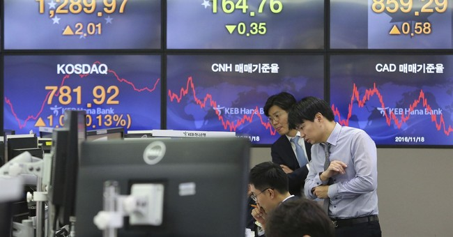 Asian stocks flat as Fed minutes show support for rate hike