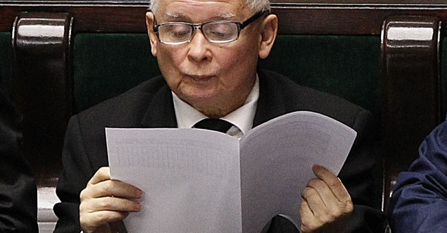 Poland's Kaczynski reads book about cats in parliament