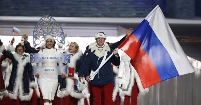 As 4 more Russians banned, Olympic leader Bach warns critics