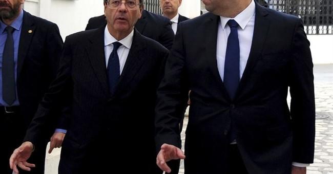Italy premier in Tunisia to discuss migration, Libya, terror