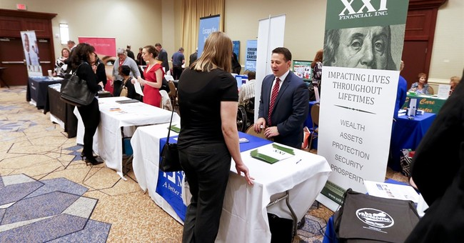 US unemployment claims slide by 14,000 to 246,000