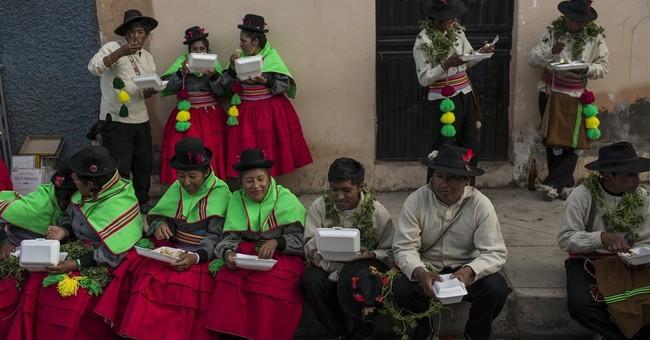 AP PHOTOS: Peru highlands revel in blast of festival color