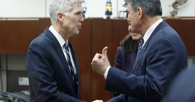 Dems in Trump states face pressure on Supreme Court pick