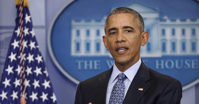 Congress scraps Obama rules on coal mining, guns