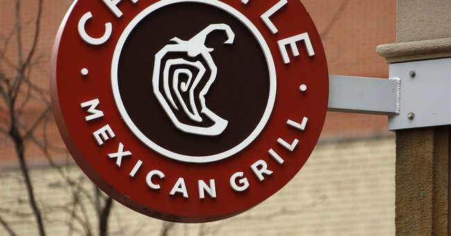 Chipotle looks to rebuild after food scares bite into profit