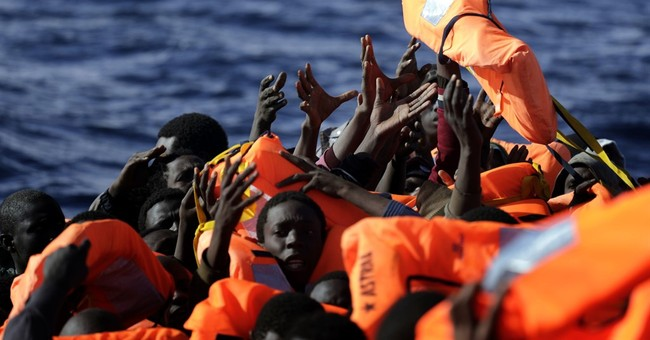 The Latest: Italy: Deal with Libya will cut migrant influx