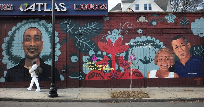 Murals send message of love to immigrants past and present