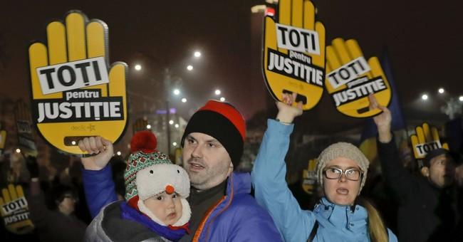 Thousands protest Romania's tax, justice laws