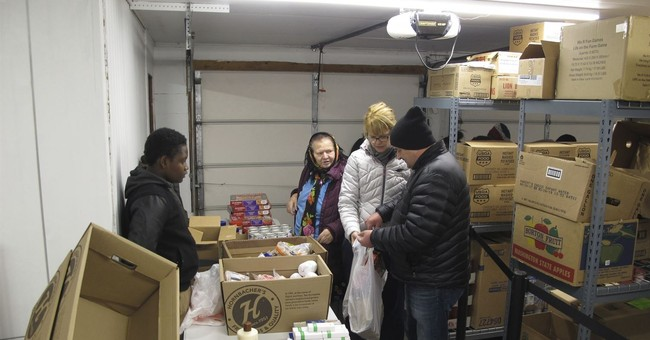 Refugees thank adoptive North Dakota city by feeding hungry