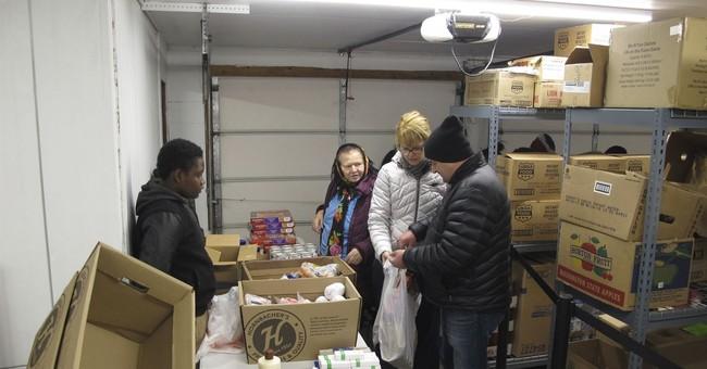 Refugees thank adoptive North Dakota city by feeding hungry