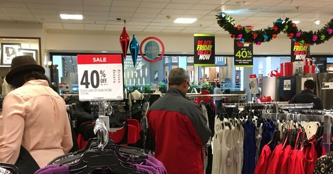 Dry weekend draws shoppers even as online sales boom
