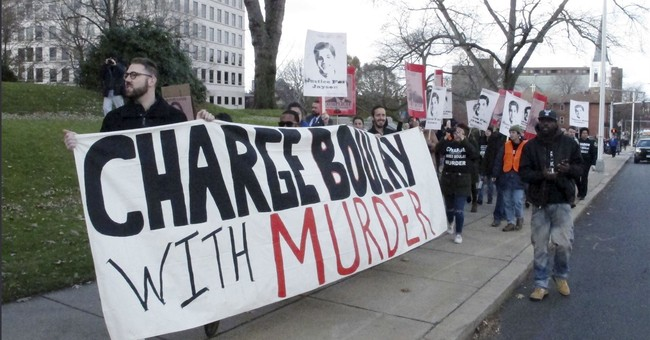 Protesters call for charges against officer who killed teen