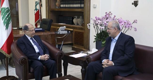 Lebanese PM threatens to resign over Hezbollah influence