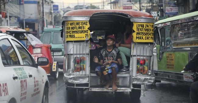 AP PHOTOS: Upgrade may dethrone Manila's 'King of the Road'