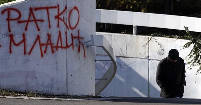 Graffiti, soccer fans hail Mladic after genocide verdict