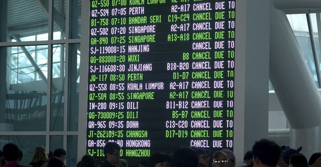 The Latest: Flights trickle from Bali after airport reopens