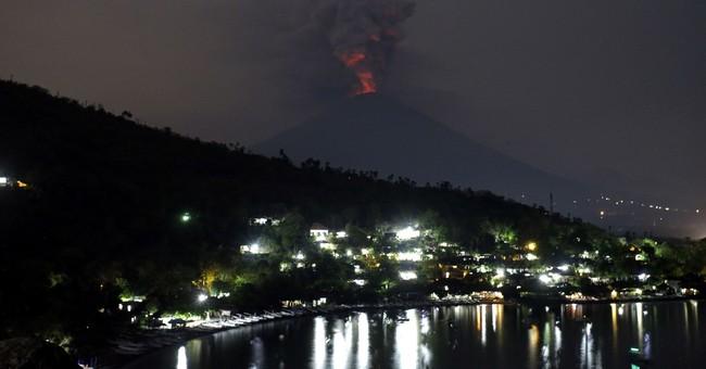 AP PHOTOS: Bali volcano gushes ash as major eruption feared