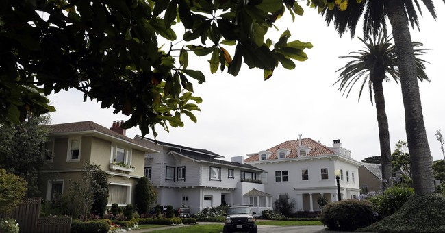 The Latest: Rich homeowners get their private street back