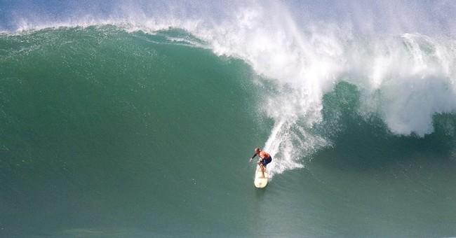 """APNewsBreak: Family says no """"Eddie"""" surf contest this season"""