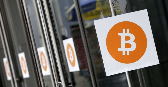Bitcoin surges past $10,000 threshold, only to plunge