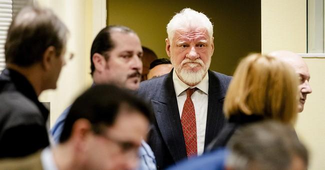 War crimes defendant 'drank' poison in court