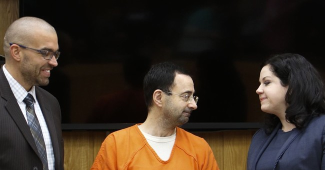 Feds seek 60-year prison sentence for Michigan sports doctor