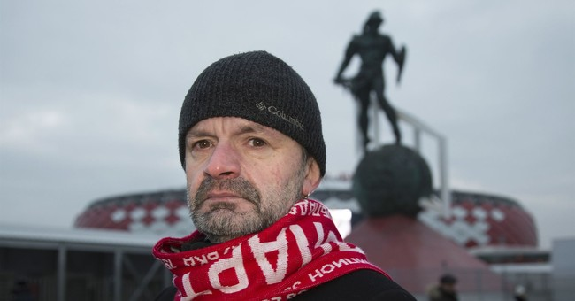 AP PHOTOS: Scarf-wearing Russian fans show their colors