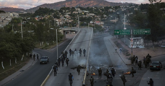 Amid disturbances, Honduras to hand-count final votes