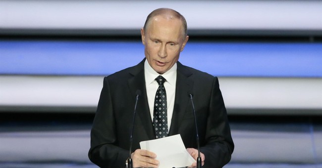 With Russian sports under a cloud, Putin vows warm welcome