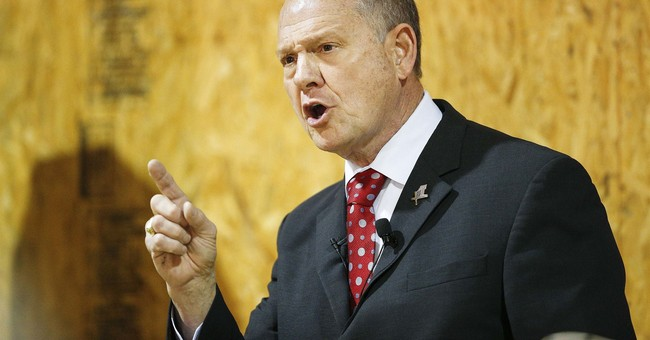 Amid accusations, Roy Moore fighting for campaign cash