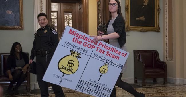 Tax bill clears Senate in big boost for Trump, GOP