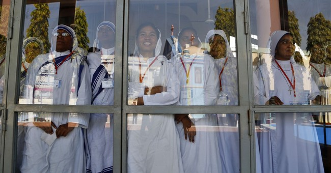 Pope defends Myanmar silence, says he spoke truth in private
